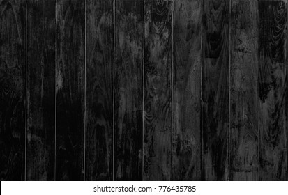 grungy black wood texture background with beautiful details of black natural pattern for background, wallpaper and web design, vertical line