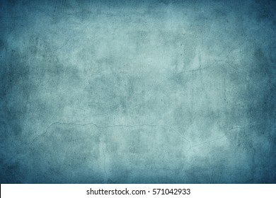 Grungy blue concrete wall texture background.