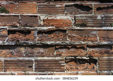 Grungy broken brick wall