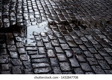 Grungy cobblestone street with puddles, New York City