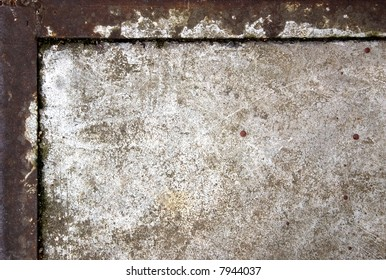 Grungy concrete in rusty iron frame