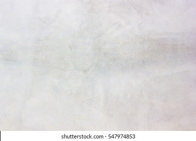 Grungy concrete wall and floor as background texture.