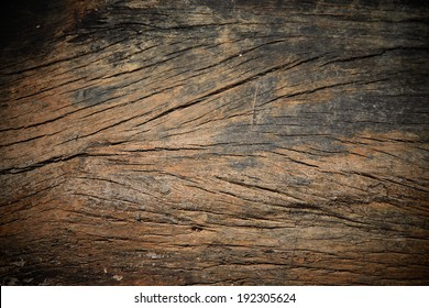 Grungy cracked wooden board by closeup textured background