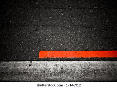 grungy, dirty view of asphalt with distinct red stripe