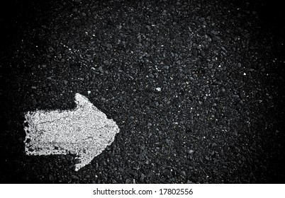 grungy, dirty view of asphalt with right arrow
