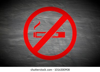 grungy dont smoke sign painted on grey trowelled wall surface texture background
