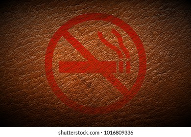 grungy dont smoke sign painted on brown leather texture texture background