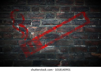 grungy dont smoke sign painted on dark old grungy brick wall texture background