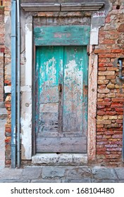 grungy door in a Venice brick wall