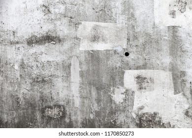 Grungy empty concrete wall with white paint brush strokes, background texture