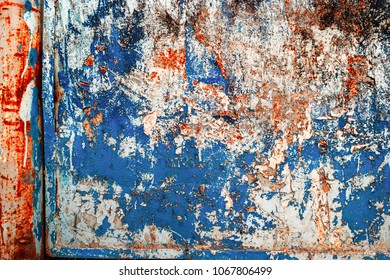 Grungy Frame Of Weathered Wall With Peeling Blue Paint
