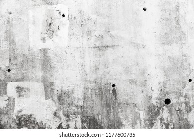 Grungy gray concrete wall with white paint brush strokes, background texture