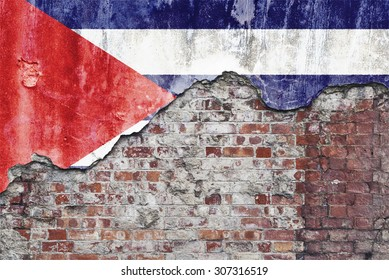 Grungy old brick wall with Cuban flag on broken render surface