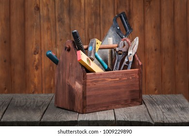 grungy old tools on a wooden background.