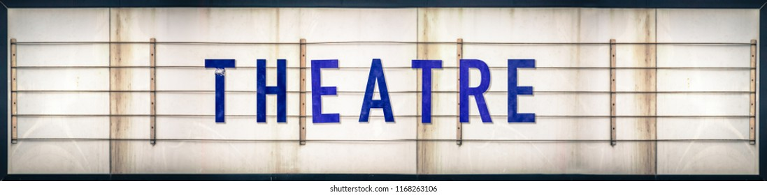 A Grungy Old Weathered Theatre Marquee Sign With Blue Letters