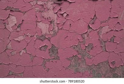Grungy peeling black, rosy brown and dim grey painted rough wall texture with scratches