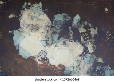 grungy peeling blue paint on rusty metal surface