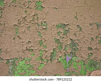 Grungy peeling silver, dark olive green and grey painted rough wall texture with scratches