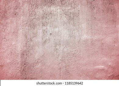 Grungy pink wall texture  background. Plastered and dyed wall surface.