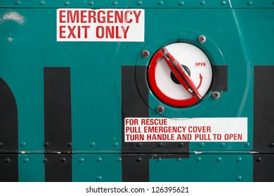 grungy red emergency exit text on helicopter