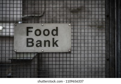 A Grungy Sign For A Food Bank In A Backstreet