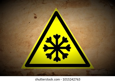grungy snow warning sign painted on old retro paper texture background