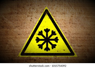 grungy snow warning sign painted on scratched wooden board texture background