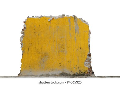A grungy stained broken brick wall isolated against white.