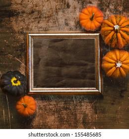 Grungy textured halloween frame with five pumpkins