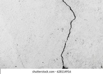 Grungy wall with large crack cement floor texture,cement large crack for background