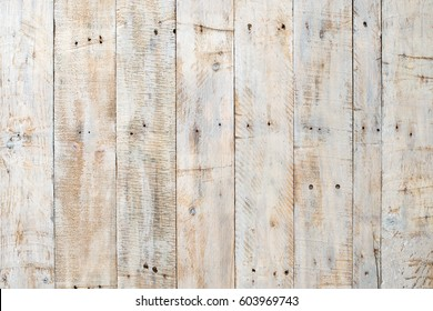 Grungy white paintwork on a wooden panel