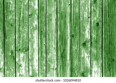 Grungy wooden wall background in green color. Abstract background and texture for design.