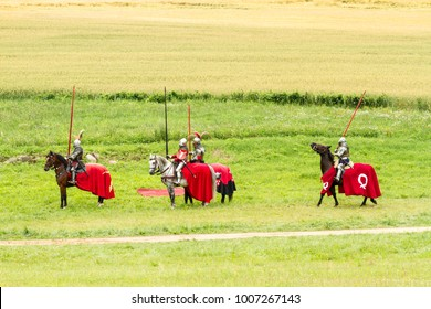 """GRUNWALD, POLAND - July 22, 2016: Festival """"Grunwald 2016"""". The battle of knights of different countries in the armor of the XIV century."""
