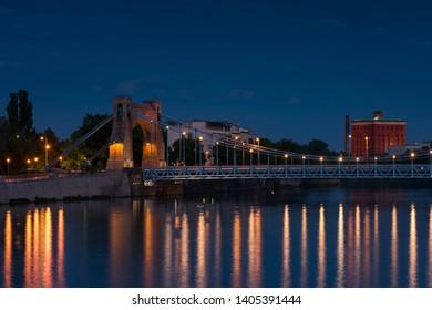 Grunwaldzki Bridge in Wroclaw, Poland with reflection in Odra River. Beautiful Night in city skyline, Breslau, 2019.
