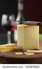 Gruyer / appenzeller swiss cheese and knife on the cheese board