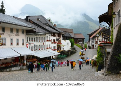 GRUYERES, SWITZERLAND - JULY 8, 2014:  The town of Gruyeres. The medieval town is an important tourist location in the upper valley of the Saane river.