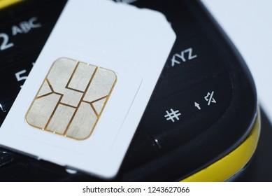 GSM sim card on cell phone close up macro tech