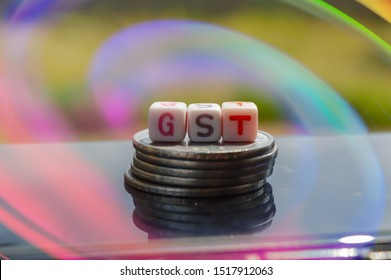 GST  and colourful line top view,GST standing on coins