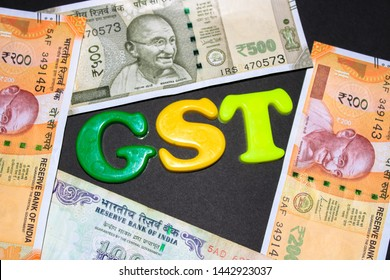 GST concept, GST alphabet on money background, business and financial idea,Indian currency, Rupee, Indian Money, Business, Finance, Investment Saving and Corruption
