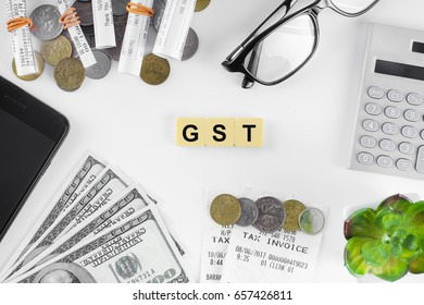 GST word on yellow tiles isolated in white background