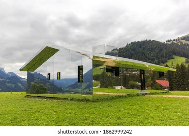 Gstaad, Switzerland - September 07, 2020: The mirror house by Doug Altken on the Swiss Alps to reflection landscape