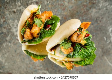 Gua bao, steamed buns with chicken and vegetable. Asian cuisine