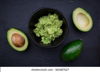 Guacamole, Avocado cream in bowl, avocados
