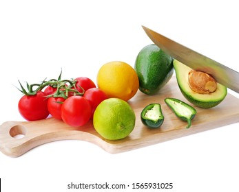 Guacamole avocado spread ingredients on wooden board over white background.