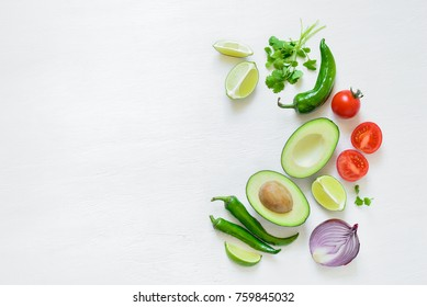 Guacamole cooking ingredients concept background with a space for a text, flat lay arrangement, overhead view