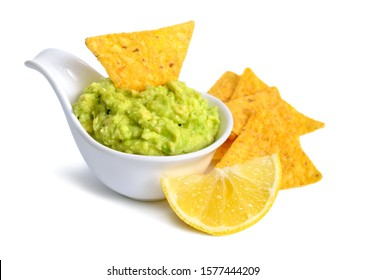 Guacamole with nachos. Isolated on white background.