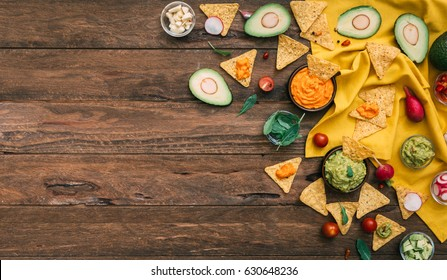 Guacamole with Nachos on plate. Mexican traditional food, Rustic style. Top view. Copy space