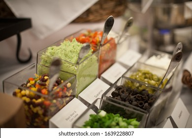 Guacamole and Salsa Set up in a Taco Bar Buffet Line