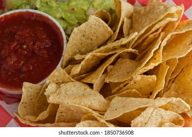 Guacamole served with crispy homemade corn tortilla chips and spicy salsa. Avocados diced and mixed with lemon and lime juices and seaside with Mexican spices. Classic Tex-Mex restaurnt appetizer.
