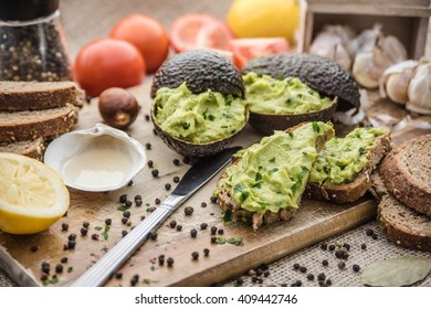 guacamole is tasty eating on wooden table